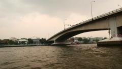 Concrete bridge span and support as seen from river water, perspective view Stock Footage