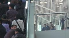 Chinese people, train station escalators Stock Footage
