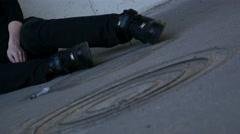 Drug addict girl laying unconscious alone, syringe near, dolly. - stock footage