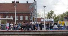 People Stand On The Platform Wait For The Train Main Railroad Station In Opole Stock Footage