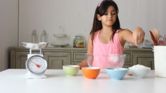 Little girl show how she is baking tahini cookies  Stock Footage