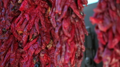 Dried red chili peppers hanging at the local Farmer's Market. Stock Footage