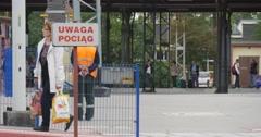 Railroad Station In Opole Poland Railroad Worker In Orange Vest People Walk Stock Footage