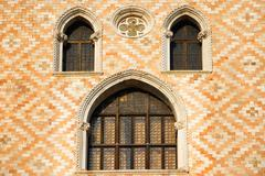 Old window and ornament wall in Venice - stock photo