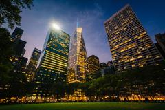 Stock Photo of Skyscrapers in Midtown at night, seen at Bryant Park in Manhattan, New York.