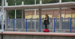 Girl With Red Bag Stands On The Platform At The Railroad Station The Wind Stock Footage