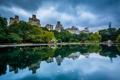Buildings reflecting in the Conservatory Water in Central Park, in Manhattan, Stock Photos