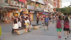 Shoppers walking at riverside market - stock footage