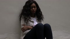 Upset depressed unhappy african girl aimlessly sitting alone. Stock Footage