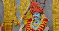 5120x2700, 5k video - Sculpted image of a Hindu god with blue skin, adorned w Stock Footage