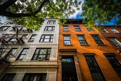 Brick apartment buildings in  Chelsea, Manhattan, New York. - stock photo