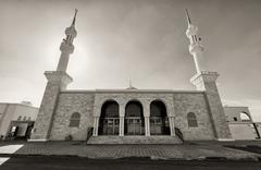 Black and white mosque with two minarets - stock photo