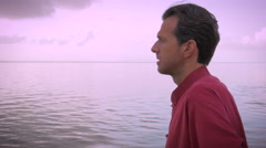 A middle aged man worries about his future and contemplates his problems Stock Footage