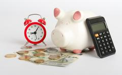 Piggy bank with alarm clock Stock Photos