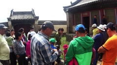Tourists listening to the guide in the ancient Mongolian monastery complex Stock Footage
