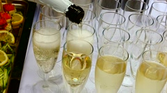 Champagne poured into glasses. Stock Footage