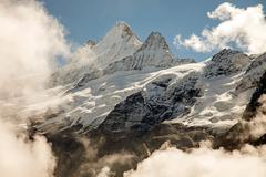 Clouds, ice and snow caps on Eiger,near Grindelwald, Switzerland Stock Photos