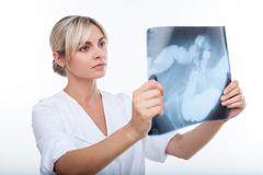 Beautiful young female doctor is analyzing human health Stock Photos