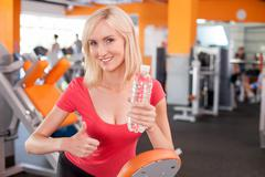 Beautiful fit woman is resting after exercising Stock Photos