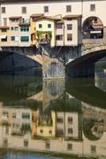 Florence, Ponte Vecchio and Arno river. - stock photo