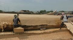 Ghana african fisherman boat woodworker  back 4K Stock Footage