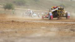 Sports cars buggies compete with each other Stock Footage