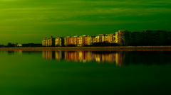 Urban landscape with lake at sunset.Mirror-like lake - stock footage