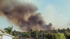 Smoke billowing over neighborhood Stock Footage