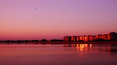 Urban landscape with lake at sunset Stock Footage