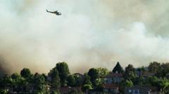 Helicopter flying over neighborhood Stock Footage