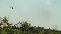 Helicopter dropping water on fire 7 Stock Footage