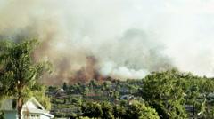 Smoke over neighborhood 2 Stock Footage