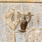 Armenian tribute relief detail Persepolis Stock Photos