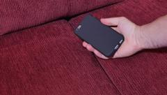 Finding Cellphone in Sofa Cushions Stock Footage