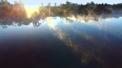 Breathtaking Scenic Aerial Flyover of Steaming River at Daybreak Stock Footage