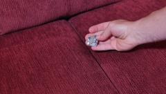 Finding Diamond Ring in Sofa Cushions - stock footage