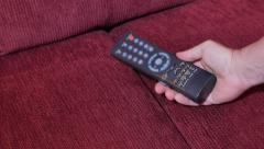Finding Remote Control in Sofa Cushions Stock Footage