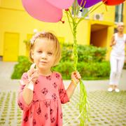 mother and child with colorful balloons - stock photo