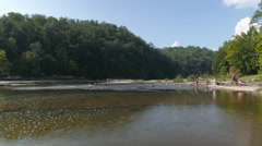People Wading in the Cumberland River near Falls in Kentucky Stock Footage