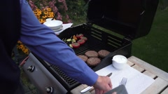 Cooking burgers on barbecue Arkistovideo