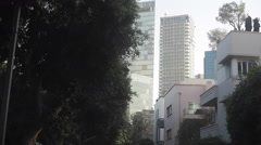 Drive through Rotschild boulevard skyscrapers in Tel-Aviv Stock Footage