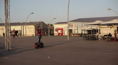 Woman rides Segway alone in Tel-Aviv port during war siren drill - stock footage