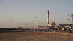 Tel-Aviv port boardwalk with power station in the background - stock footage