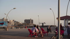 Tel-Aviv port boardwalk during sunset, pan left Stock Footage