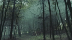 Chased through a foggy forest. POV shot - stock footage