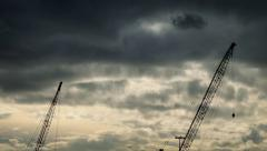 Large Cranes Against Dramatic Moving Sky Stock Footage