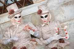 VENICE, ITALY - FEBRUARY 27, 2014: Unidentified person with Venetian Carnival Stock Photos