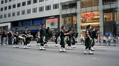 Parade of bagpipe players Stock Footage