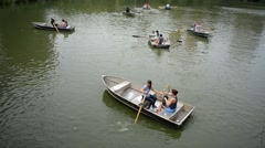 Row boats in central park Stock Footage