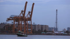 Klong Toey Port, Bangkok, Thailand- Crane lifting cargo from ship Stock Footage